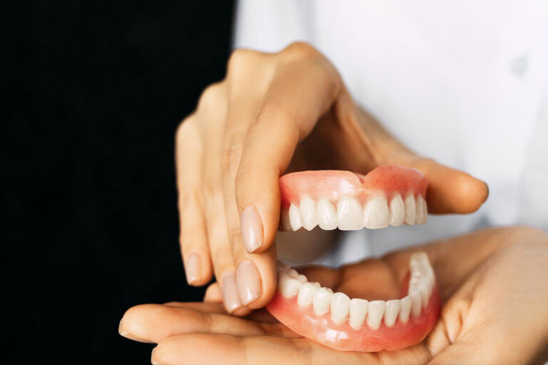 denture mouth model in dentist's hands
